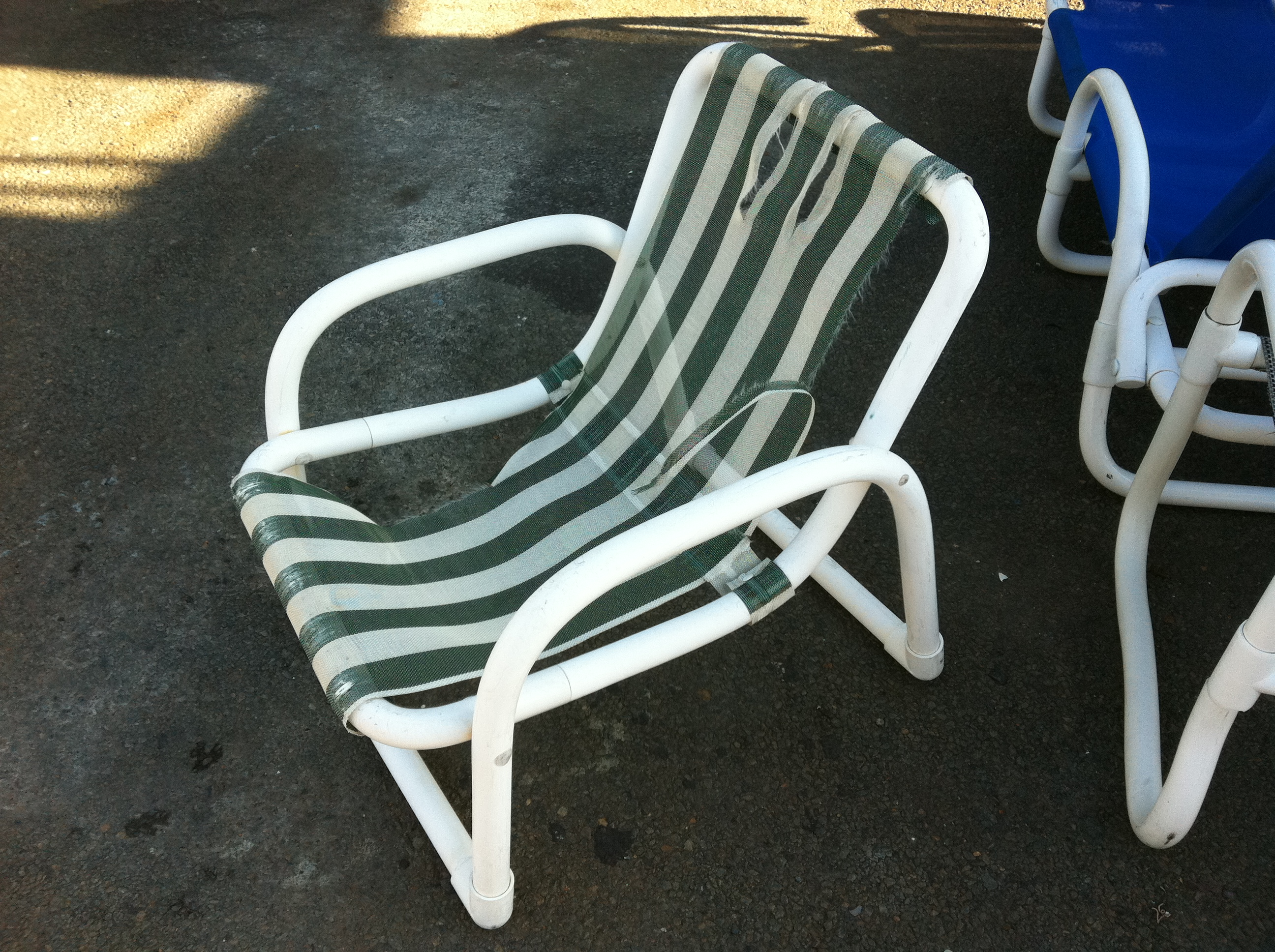 Pvc chair with torn sling